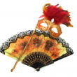 Bright mask and a fan on a white — Stok fotoğraf