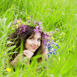 Girl, lying on the grass field - Stockfoto