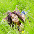 Stock Photo: Girll, lying on the grass field