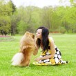 Girl playing with dog in park — Stock fotografie #7489199