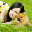 Girl playing with dog in park — Stock fotografie #7489209