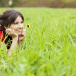 Beautiful girl lying on the grass — Stock Photo #7489254