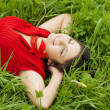 Beautiful girl lying on the grass — Stock Photo #7489266