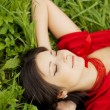 Beautiful girl lying on the grass — Stock Photo #7489281