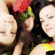 Two beautiful girls lying on the grass. — Stock Photo #7489303