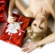 Santa girl lying under the tree — Stock Photo #7489341