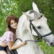 Brunette girl with horse — Stock Photo #7489346