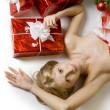 Foto Stock: Santa girl lying under the tree