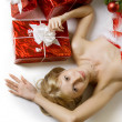 Santa girl lying under the tree — ストック写真