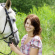 Brunette girl with horse - Stock Photo