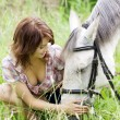 Brunette girl with horse — Stock Photo #7489384