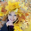 Girl in the autumn wreath — Stock Photo
