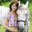 Brunette girl with horse — Stock Photo #7489404