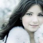 Girl in winter city — Stock Photo