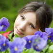 Girl with spring flowers — Stock Photo #7489497