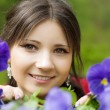 Stock Photo: Girl with spring flowers