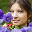 Girl with spring flowers — Stok fotoğraf