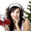 Santgirl deploying boxes with gifts — Stock Photo #7489533