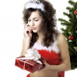 Stock Photo: Santgirl deploying boxes with gifts