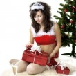 Stock Photo: Santa girl deploying boxes with gifts
