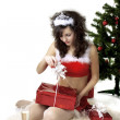 Santa girl deploying boxes with gifts — Stockfoto