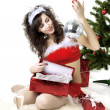 Santa girl deploying boxes with gifts — Stock Photo