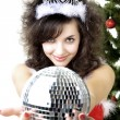 Santa girl disco ball in the hands - Stock Photo