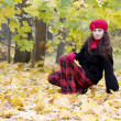 Womin red in autumn park — Foto Stock #7489591