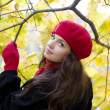 Woman in red in autumn park — Stock Photo #7489594