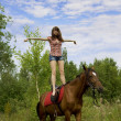 Brunette girl with horse — Stock Photo #7489797