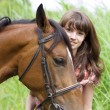 Brunette girl with horse — Stock Photo #7489799