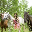 Brunette girl with horses — Foto Stock