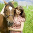 Brunette girl with horse — Stock Photo #7489813