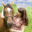 Brunette girl with horse — Stock Photo #7489817