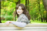 Girl on a park bench — Stock Photo