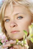 Beautiful girl in a flowering garden — Stock Photo