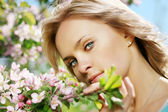 Beautiful girl in a flowering garden — Stock Photo