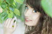Girl with blue eyes in the foliage — Stock Photo