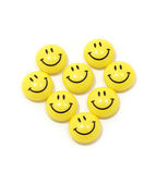 Heart made of yellow smileys — Stock Photo