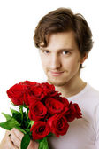 Homem bonito, com um buquê de rosas — Fotografia Stock