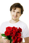 Bel homme avec un bouquet de roses — Photo