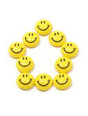 Symbol of a house made of yellow smileys — Stock Photo