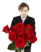 Beautiful man with a bouquet of roses — Stock Photo