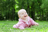 Child lying on the grass — Stock Photo