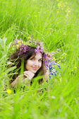 Girl, lying on the grass field — Stock Photo