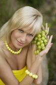 Girl with grapes — Stock Photo