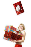 Santa girl with presents on white background — Stock Photo