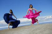 Girls dancing on the sky — Stock Photo