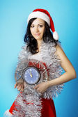 Santa, with a clock — Stock Photo