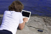 Man with a laptop in an outdoor — Stock Photo